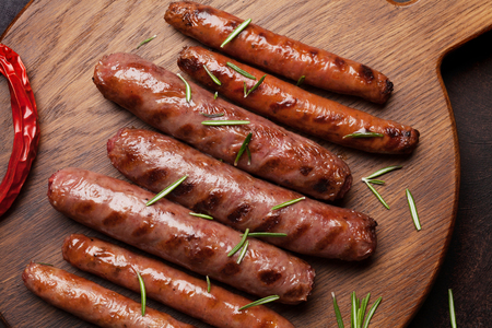 Grilled sausages with rosemary herbs. Top view 스톡 콘텐츠 - 121068255