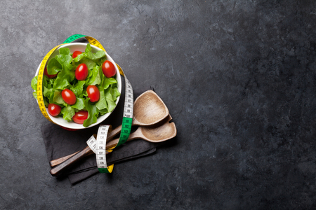 Healthy food and fitness concept. Fresh salad with tomatoes. Top view flat lay with copy space for your text Stock Photo