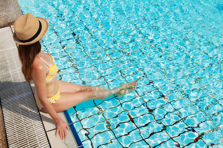 Young attractive woman relaxing in swimming pool. With copy space for your text Stock Photo