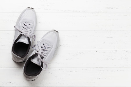 Fitness and healthy life concept. Sneakers on wooden table. Top view with copy space for your text Stock Photo