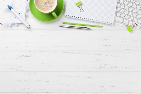 Office workplace table with coffee cup, supplies and computer. Flat lay. Top view with space for your goals