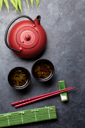 Green tea and sushi chopsticks. Japanese meal set. Top view with space for your text