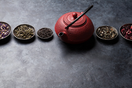 Various dry tea assortment and teapot. Black, green and herbal tea. With space for your text Stok Fotoğraf
