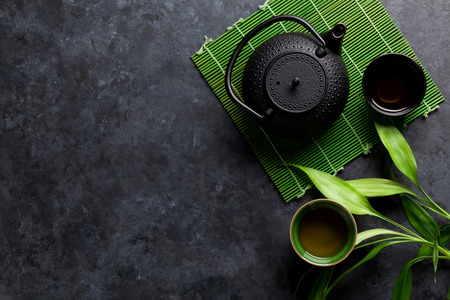 Green japanese tea on stone table. Top view with copy space Stock Photo