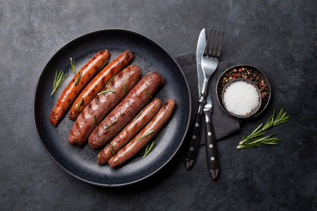 Grilled sausages with rosemary herbs. Top view