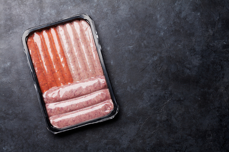 Raw sausages in tray. Top view with copy space Stock Photo - 123911417