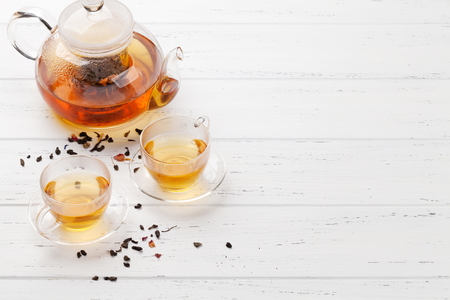 Herbal and fruit tea, teapot and cups on wooden table. With copy space Stok Fotoğraf