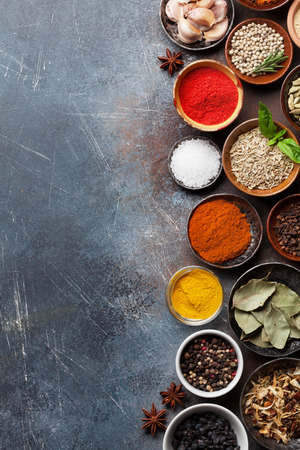 Set of various spices and herbs on stone background. Top view with space for your recipe. Flat lay Banco de Imagens