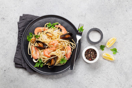 Spaghetti seafood pasta with clams and prawns. Top view with copy space. Flat lay