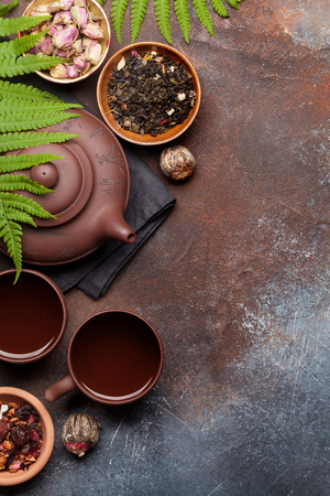 Herbal and fruit dry teas on stone table. Top view flat lay with copy space Stok Fotoğraf
