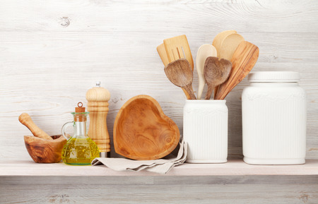 Set of various kitchen utensils. In front of wooden wall with copy space for your text Foto de archivo