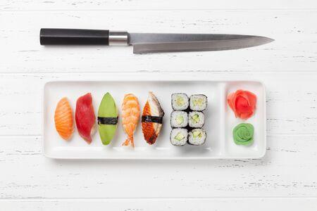 Japanese sushi set. Sashimi, maki rolls. On plate over white wooden background Stock Photo