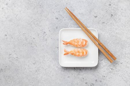 Japanese sushi set with shrimps. Ebi. On plate over stone background with space for your text
