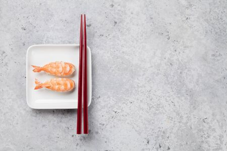 Japanese sushi set with shrimps. Ebi. On plate over stone background with space for your text Stock Photo - 127658500