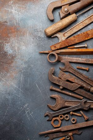 Vintage old tools on stone backdrop. Top view with copy space. Flat lay 版權商用圖片