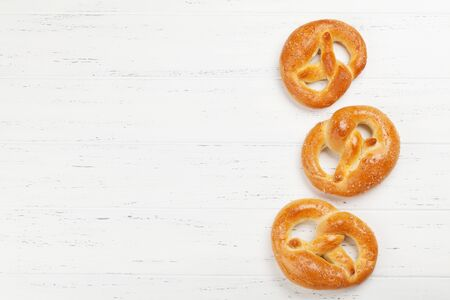 Oktoberfest food backdrop. Pretzels on wooden background. Top view with copy space. Flat lay