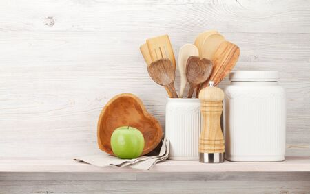 Set of various kitchen utensils. In front of wooden wall with copy space for your text Stock Photo