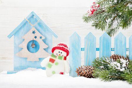 Christmas snowman and fir tree branch. Xmas greeting card Stock fotó