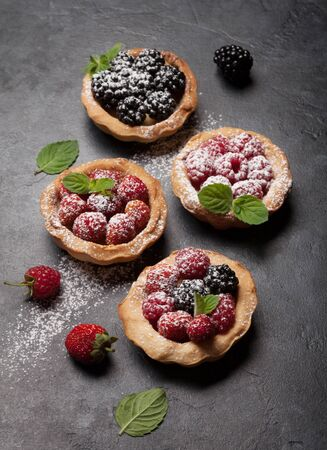 Set of sweet cakes with berries. Strawberry, raspberry and blackberry Stock fotó
