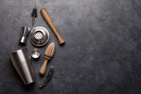 Cocktail utensils. Set of bar tools on stone table. Top view flat lay with copy space