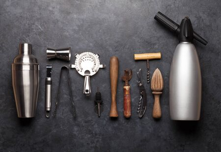 Cocktail utensils. Set of bar tools on stone table. Top view flat lay