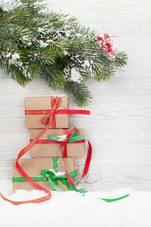 Christmas gift boxes and xmas fir tree branch. View with space for greetings