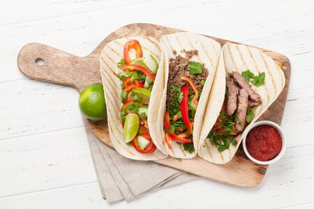 Mexican tacos with meat and vegetables in tortilla Stock Photo
