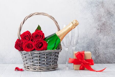 Valentine's day greeting card with red rose flowers bouquet and champagne in basket. With space for your greetings