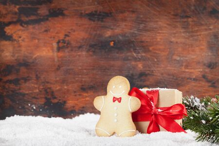 Christmas greeting card with gingerbread cookies and xmas gift box.