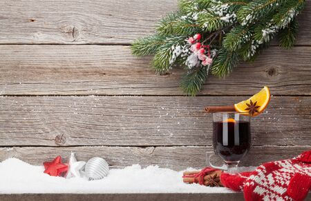 Christmas card with mulled wine hot drink, decor and xmas fir tree branch. View with space for your greetings
