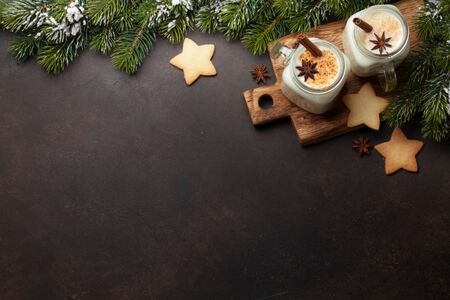 Eggnog. Traditional christmas cocktail and gingerbread cookies on stone table. Flat lay. Top view with space for your greetings