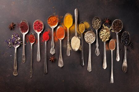 Various spices spoons on stone table. Top view Zdjęcie Seryjne