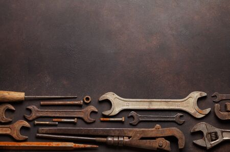 Vintage old tools on stone backdrop. Top view with copy space. Flat lay Reklamní fotografie