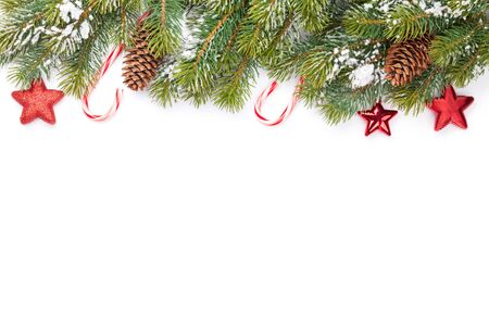 Christmas greeting card with fir tree, candy cane and decor over white background. Isolated on white. Top view flat lay with copy space for your xmas greetings