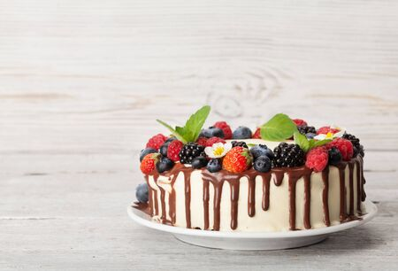 Chocolate cake or cheesecake with berries. On wooden table with copy space Stock fotó