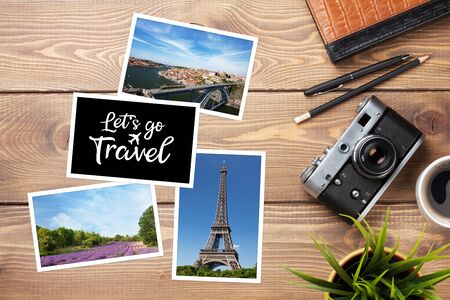 Travel photos, camera and supplies on office wooden desk table. Top view with copy space Stock fotó