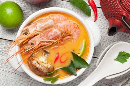 Tom yum traditional thai soup with seafood, mushrooms, coconut milk and hot spices. Top view Reklamní fotografie