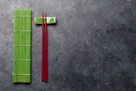 Japanese chopsticks on stone table. Asian food concept. Top view flat lay with copy space