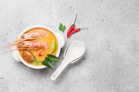 Tom Yum traditional Thai soup with seafood, mushrooms, coconut milk and hot spices. Top view with copy space Reklamní fotografie