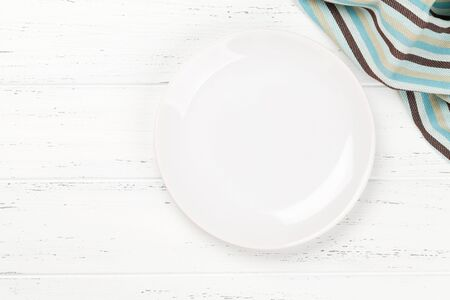 Kitchen table with empty plate, tablecloth and space for your recipe or menu. Top view flat lay Zdjęcie Seryjne
