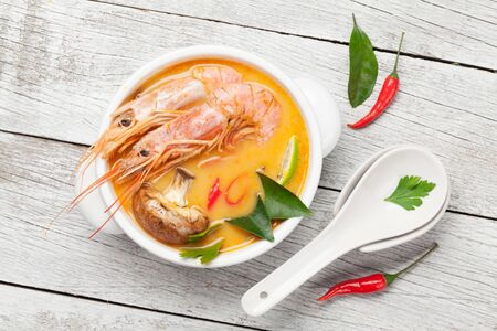 Tom Yum traditional Thai soup with seafood, mushrooms, coconut milk and hot spices. Top view