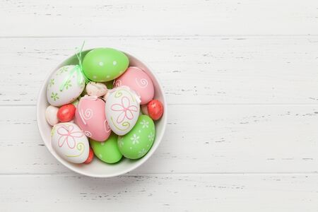 Easter greeting card with colorful easter eggs on wooden