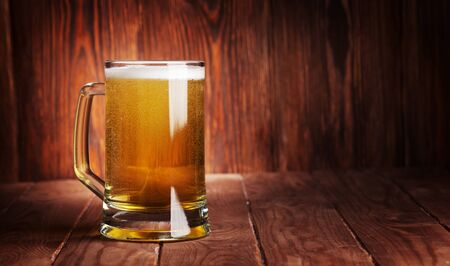 Lager beer mug on wooden table. With copy space for your text