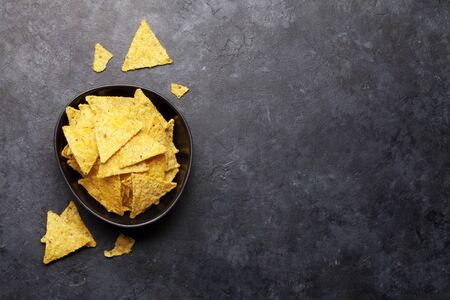 Mexican nachos chips. Top view flat lay on stone table with copy space