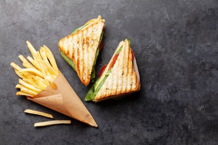 Club sandwich and potato fries chips. Fast food take away. Top view with copy space