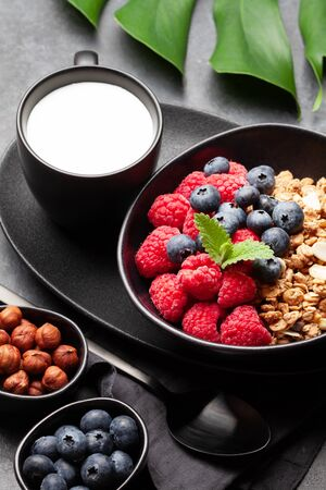 Healthy breakfast with homemade granola with yogurt and fresh berries