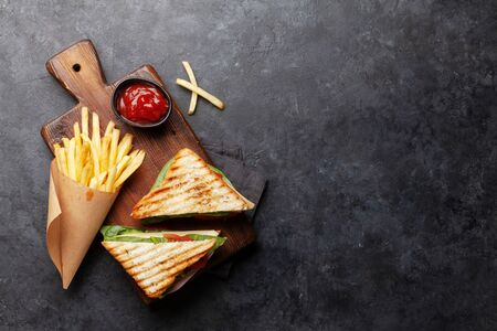 Club sandwich, potato fries chips and sauce. Fast food take away. Top view with copy space