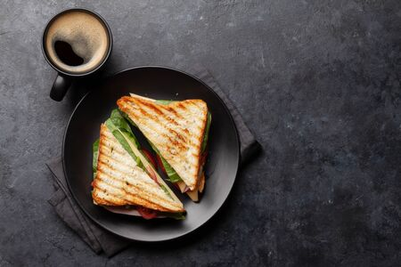 Club sandwich and coffee cup. Breakfast meal. Top view with copy space