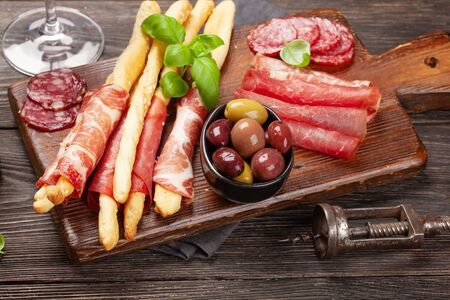 Meat and olives antipasto. Appetizer selection board