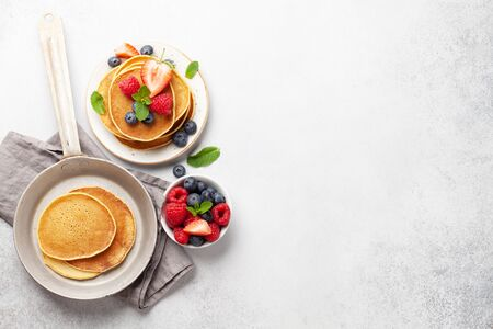 Delicious homemade pancakes with summer berries for breakfast. Morning meal. Top view with copy space Standard-Bild